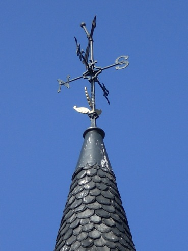 Weather vane, NSEW, blue sky, light
